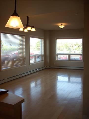 Spruce Grove Condominium. Living room (1 of 2): large open concept