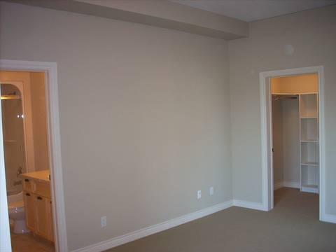 Spruce Grove Condominium. Master bedroom (2 of 2): walk-in closet and ensuite bath