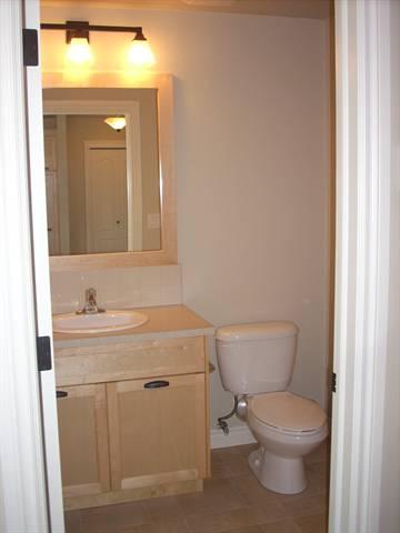 Spruce Grove Condominium. Second bath: maple cupboards and mirror