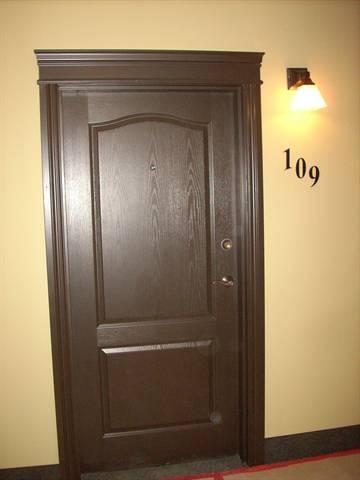 Spruce Grove Condominium. Exterior suite doorway